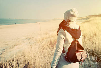 Retro Photograph - Woman With Retro Backpack On The Beach Looking At The Sea by Michal Bednarek