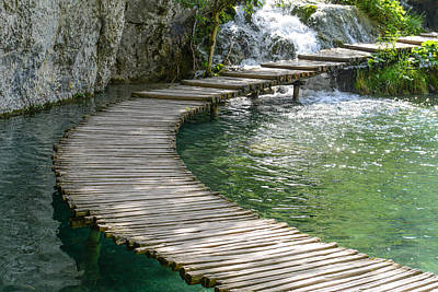 Path Photograph - Wooden Boardwalk For Hiking Next To A Lake by Brandon Bourdages
