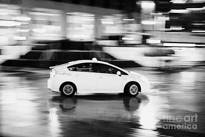 Speeding Taxi Photograph - yellow cab taxi downtown Vancouver city at night BC Canada deliberate motion blur by Joe Fox