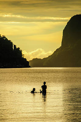 Young Boys Fishing At Sunset In The Bay Art Print