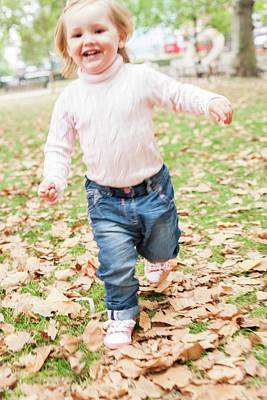 2-3 Years Photograph - Young Girl Running In The Leaves by Ian Hooton