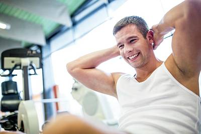 Self-confidence Wall Art - Photograph - Young Man Exercising by Science Photo Library
