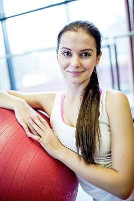 Self-confidence Wall Art - Photograph - Young Woman Leaning On Fitness Ball by Science Photo Library