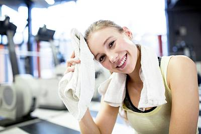 Self-confidence Wall Art - Photograph - Young Woman Wiping Her Sweat With Towel by Science Photo Library