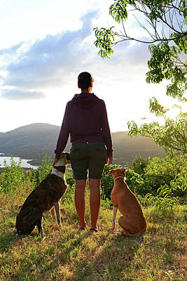 Young Woman With Her Dogs At Sunset Art Print