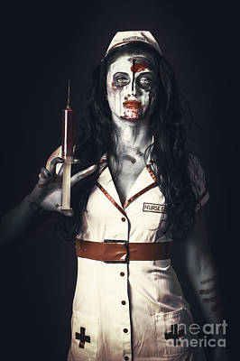 Zombie Nurse Holding Bloody Euthanasia Syringe Art Print by Jorgo Photography - Wall Art Gallery