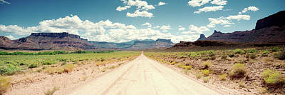 Dirt Roads Photograph - Dirt Road Passing Through A Landscape by Panoramic Images
