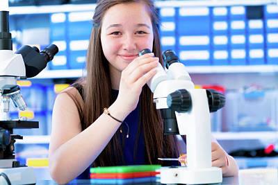 Girl Using Microscope Art Print by Wladimir Bulgar/science Photo Library