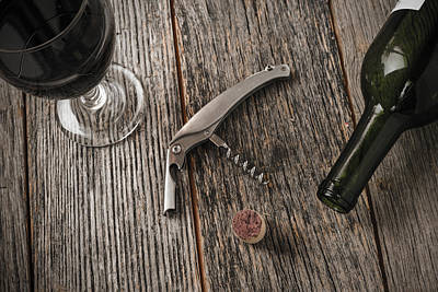 Vino Photograph - Green Wine Bottle And Cork With Red Wine And Corkscrew by Brandon Bourdages