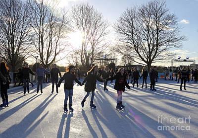 Caravaggio - Ice skating at Hampton Court Palace ice rink England UK by Julia Gavin