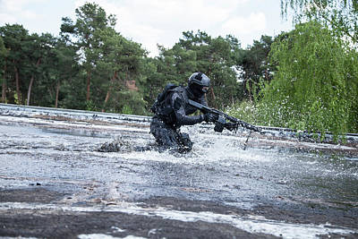 Photograph - Spec Ops Police Officer Swat In Action by Oleg Zabielin