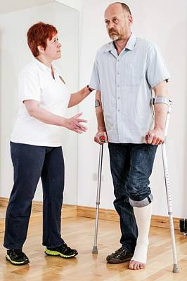 Crutch Photograph - Physiotherapy Session by Dan Dunkley