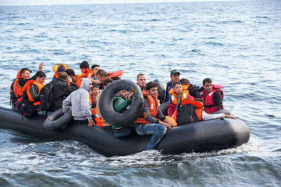 Inflatable Photograph - Syrian Refugees Arriving On Greek Island by Ashley Cooper