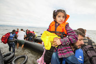 Refugee Girl Photograph - Syrian Refugees Arriving On Greek Island by Ashley Cooper