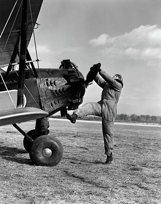 Bi-plane Photograph - 1920s Male Pilot Trying To Turn Planes by Vintage Images