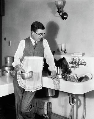 Washing Machine Photograph - 1920s Man In Apron Leaning On Sink Full by Vintage Images