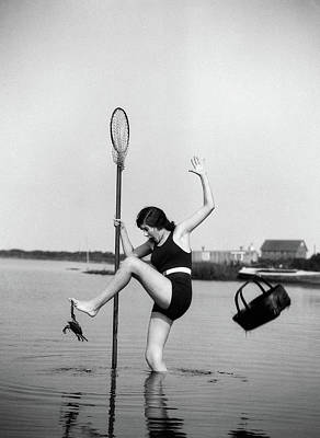 Bite Photograph - 1920s Woman Crabbing Surprised By Crab by Vintage Images