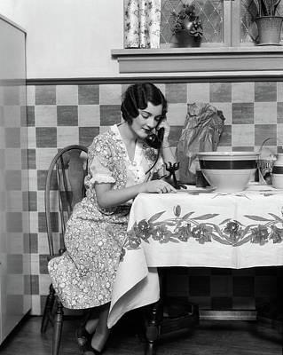 Mixing Bowls Photograph - 1920s Woman Sitting At Kitchen Table by Vintage Images