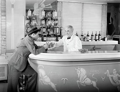 Of Liquor Photograph - 1930s 1940s 1950s Man Leaning On Bar by Vintage Images