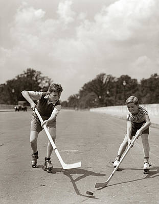 Kids Playing Hockey Photograph - 1930s 1940s 2 Boys With Sticks And Puck by Vintage Images