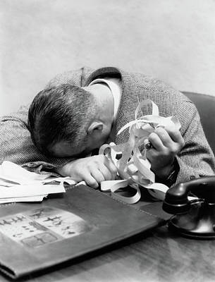 Banker Wall Art - Photograph - 1930s 1940s Man With Head Down On Desk by Vintage Images
