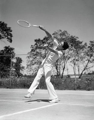 Self-confidence Wall Art - Photograph - 1930s Man Playing Tennis Swinging Racket by Vintage Images