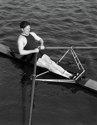 Self-confidence Wall Art - Photograph - 1930s Man Rowing Sculling Pulling Oars by Vintage Images