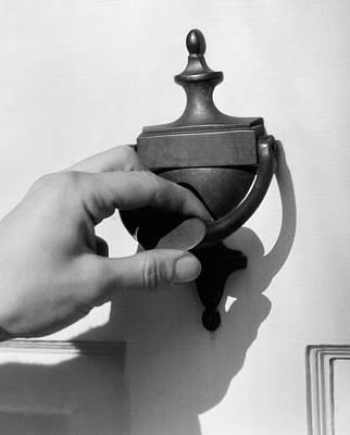 Door Knocker Photograph - 1930s Mans Hand Lifting Door Knocker by Vintage Images