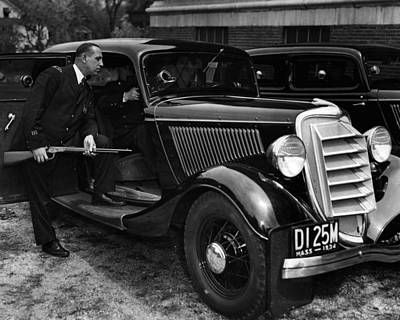 Antique Automobile Photograph - 1934 Boston Policeman Ready For Action by Retro Images Archive