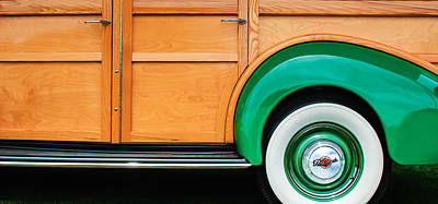 Old Woody Station Wagon Wall Art - Photograph - 1940 Packard 120 Woody Station Wagon Wheel Emblem by Jill Reger