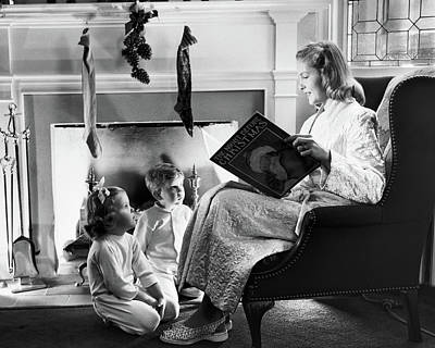 Full-length Portrait Photograph - 1940s 1950s Mother Reading Christmas by Vintage Images