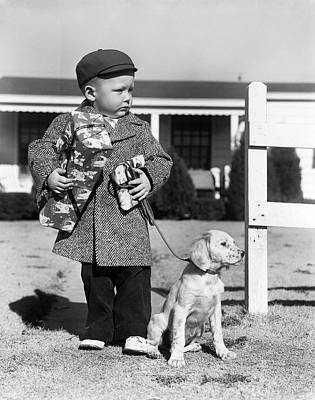 Packages Photograph - 1940s Boy With Puppy On Leash Holding by Vintage Images