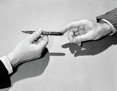 Endorsement Photograph - 1940s Fountain Pen Being Passed by Vintage Images