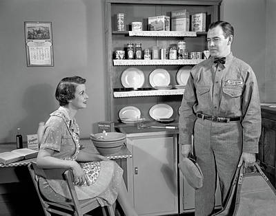 Mixing Bowls Photograph - 1940s Housewife Sitting At Kitchen by Vintage Images