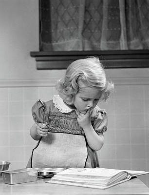 Cookbook Photograph - 1940s Little Girl Playing In Kitchen by Vintage Images