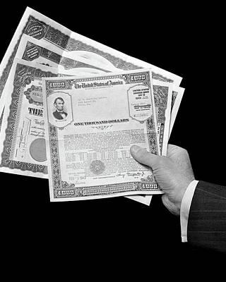 1940s Man Hand Holding Stock And Bond Art Print