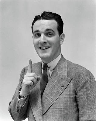 1940s Man In Suit Holding Up Index Art Print