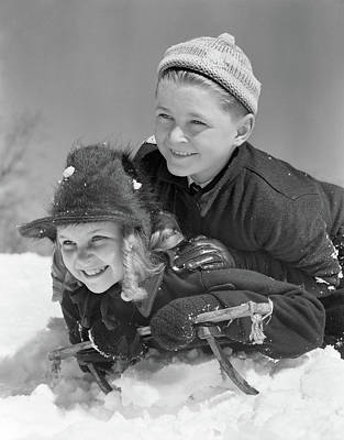Self-confidence Wall Art - Photograph - 1940s Smiling Boy And Girl Sledding by Vintage Images