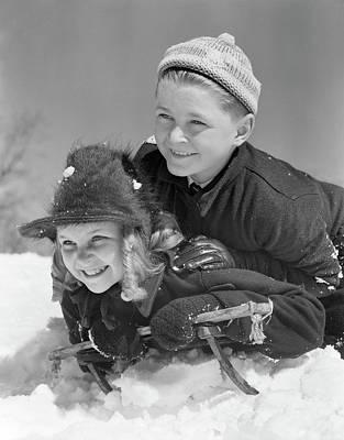 1940s Smiling Boy And Girl Sledding Art Print