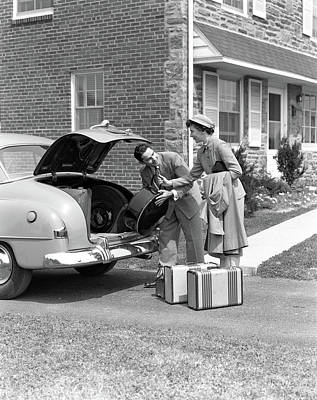 Driving Out Photograph - 1940s Smiling Couple Woman Handing Man by Vintage Images
