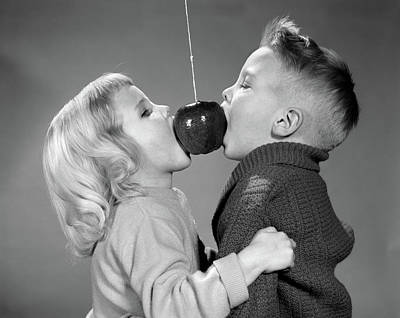 Bite Photograph - 1950s 1960s Boy Girl Couple Biting by Vintage Images