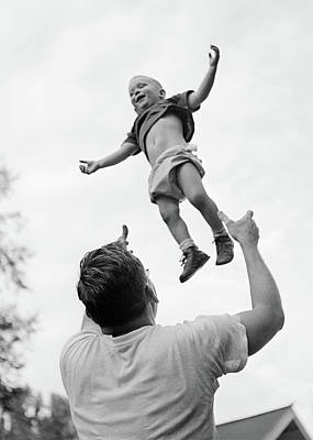 1950s 1960s Father Tossing His Son Art Print