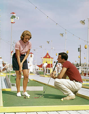 Putt Photograph - 1950s 1960s Young Couple Man Woman Play by Vintage Images