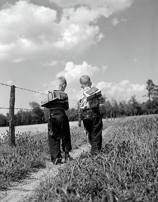 Rural Schools Photograph - 1950s Back View 2 Boys With Book Packs by Vintage Images