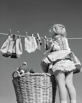 Ruffles Photograph - 1950s Back View Of Girl Hanging Laundry by Vintage Images