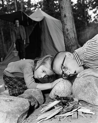Ignite Photograph - 1950s Boy Girl Blowing On Campfire by Vintage Images