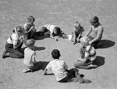 Boy And Girl Photograph - 1950s Boys & Girls Shooting Marbles by Vintage Images