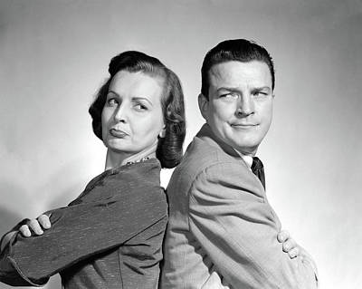 Back To Life Photograph - 1950s Couple Sitting Back To Back Arms by Vintage Images