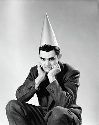 Dunce Caps Photograph - 1950s Disguntled Man Wearing Dunce Cap by Vintage Images