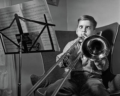 Trombone Photograph - 1950s Funny Cross-eyed Boy Playing by Vintage Images